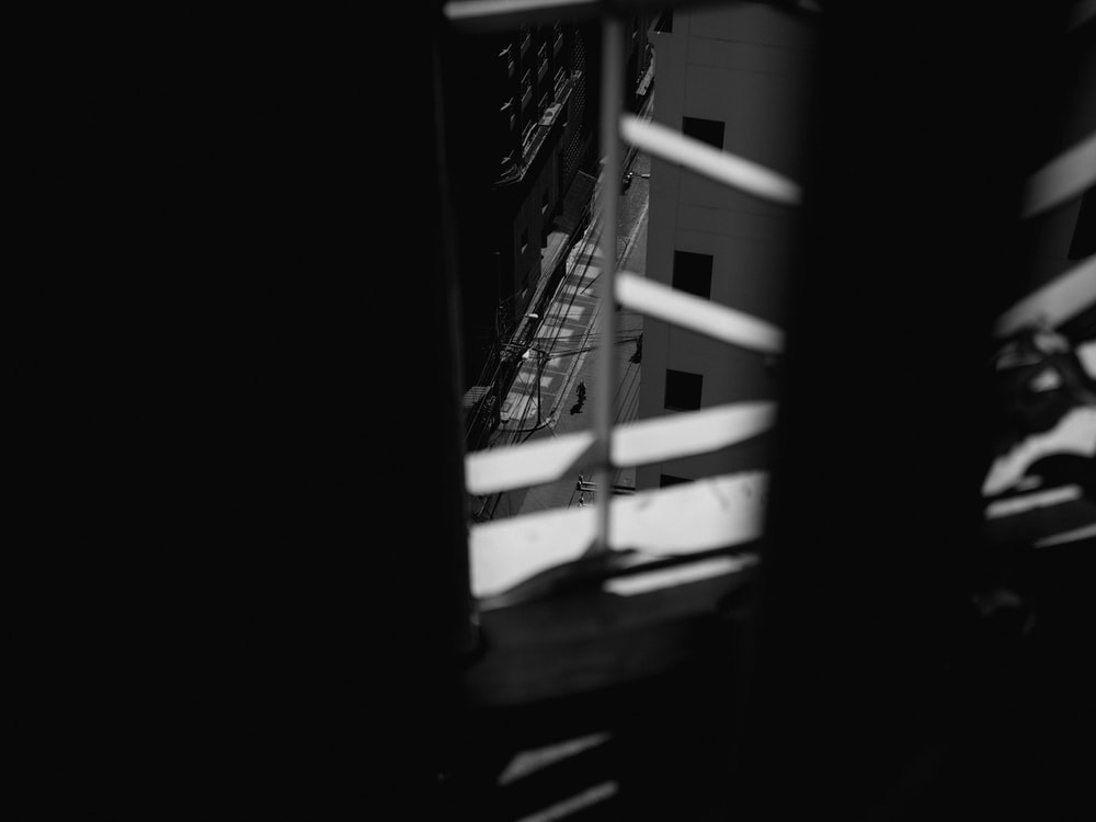 grayscale photo of a ladder