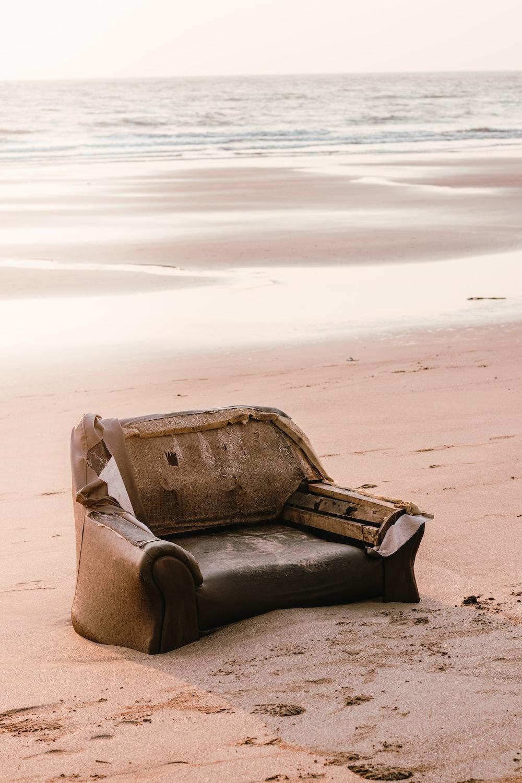 brown and gray armchair on brown sand
