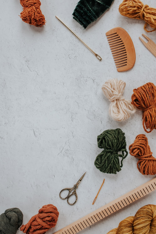 orange and white yarn on white table