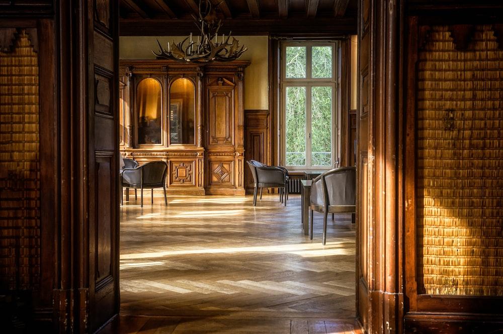 brown wooden door near brown wooden table
