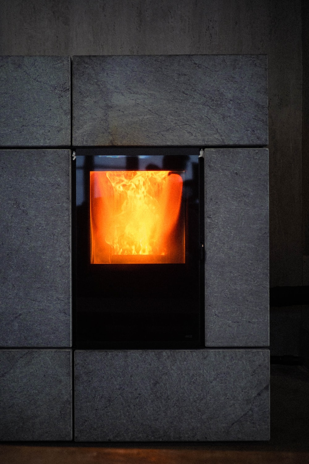 black fireplace with fire in the middle