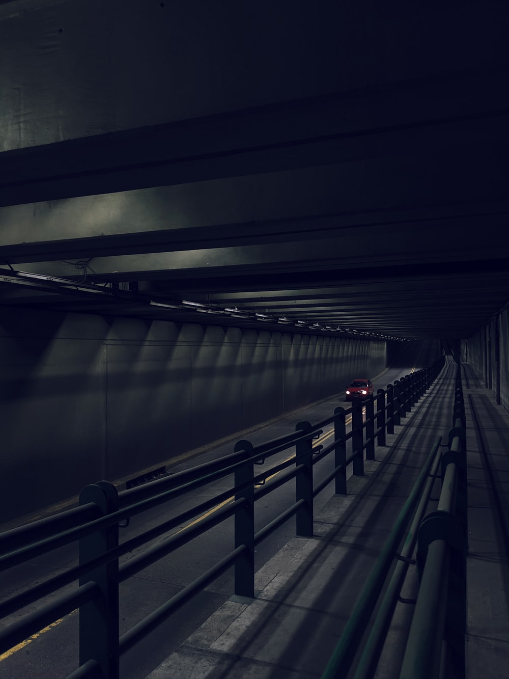 white and black train in tunnel