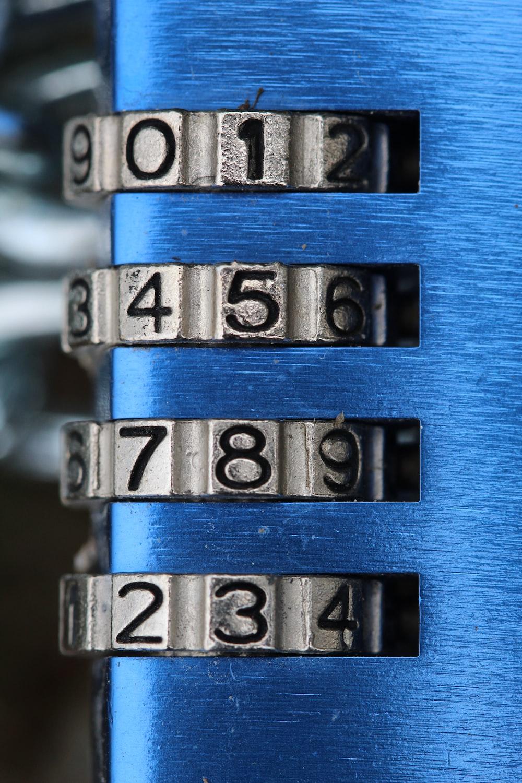 silver and black combination padlock