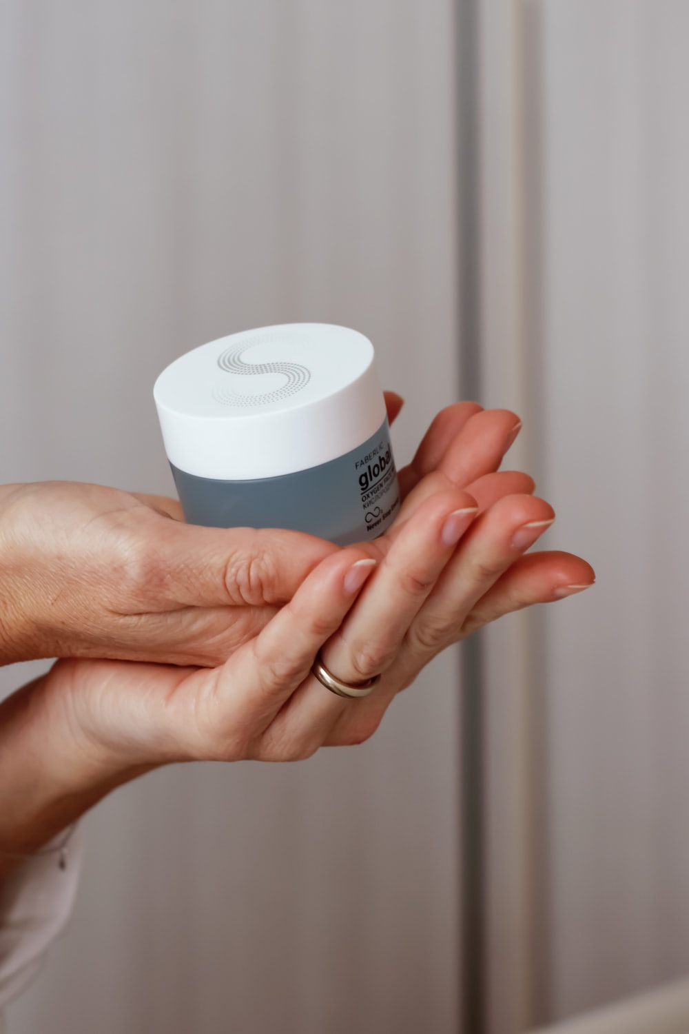 person holding white plastic cup