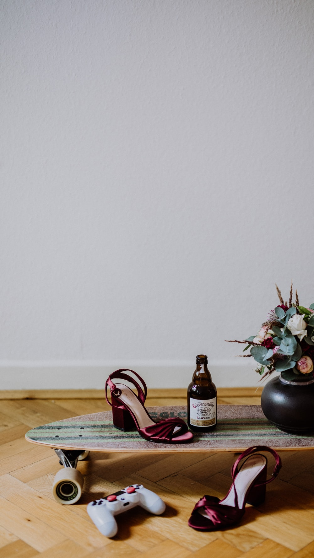 brown glass bottle beside black vase