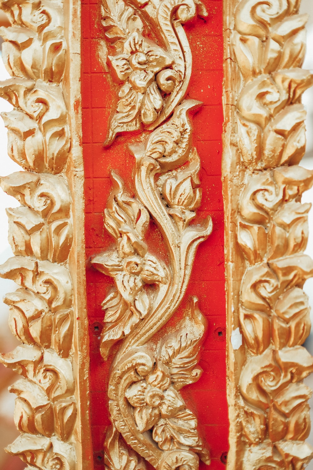 gold and red floral embossed wall decor