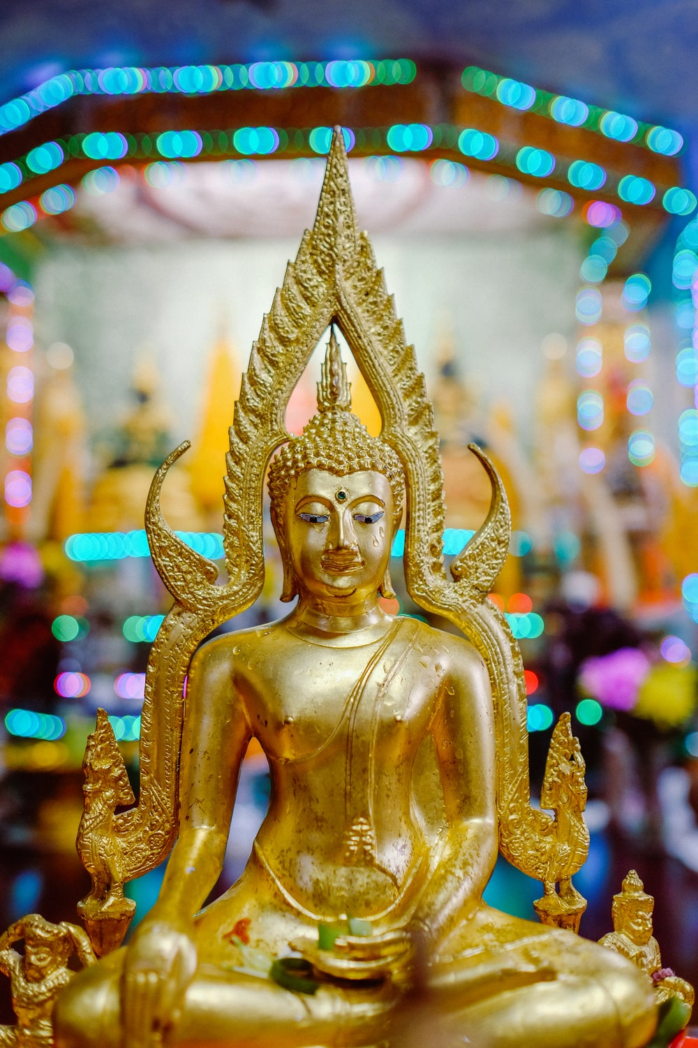 gold buddha figurine in tilt shift lens