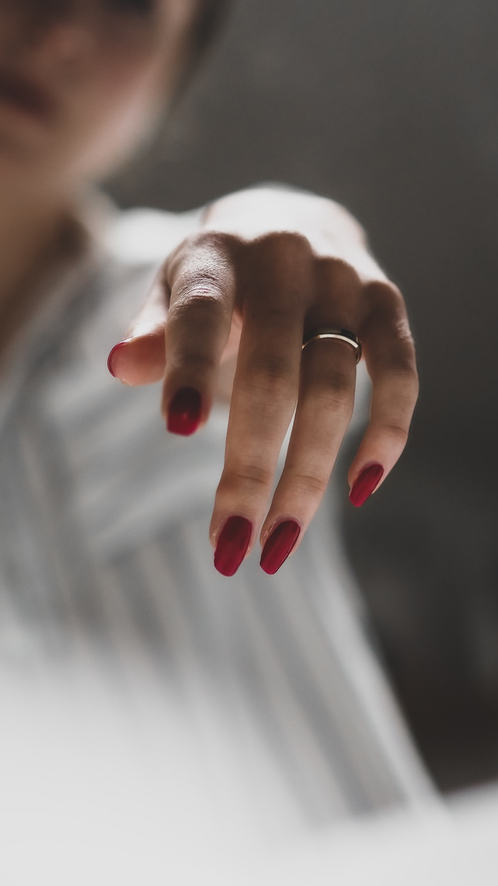 person wearing silver ring on left ring finger