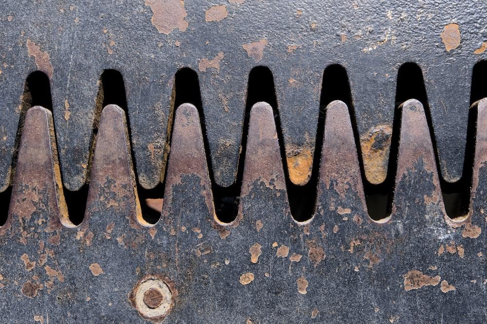gray metal pipe on gray concrete floor