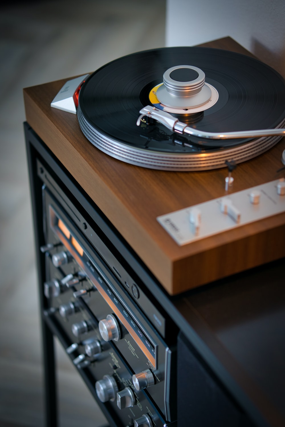 vinyl record player on brown wooden table