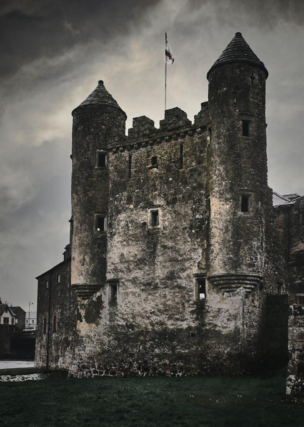 gray concrete castle under cloudy sky