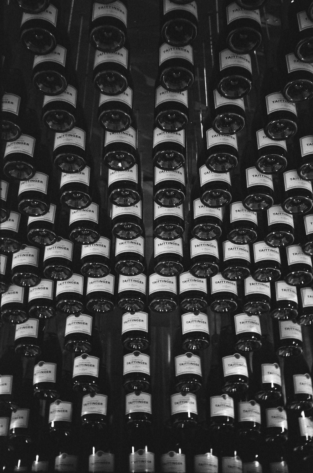 black glass bottles on brown wooden shelf