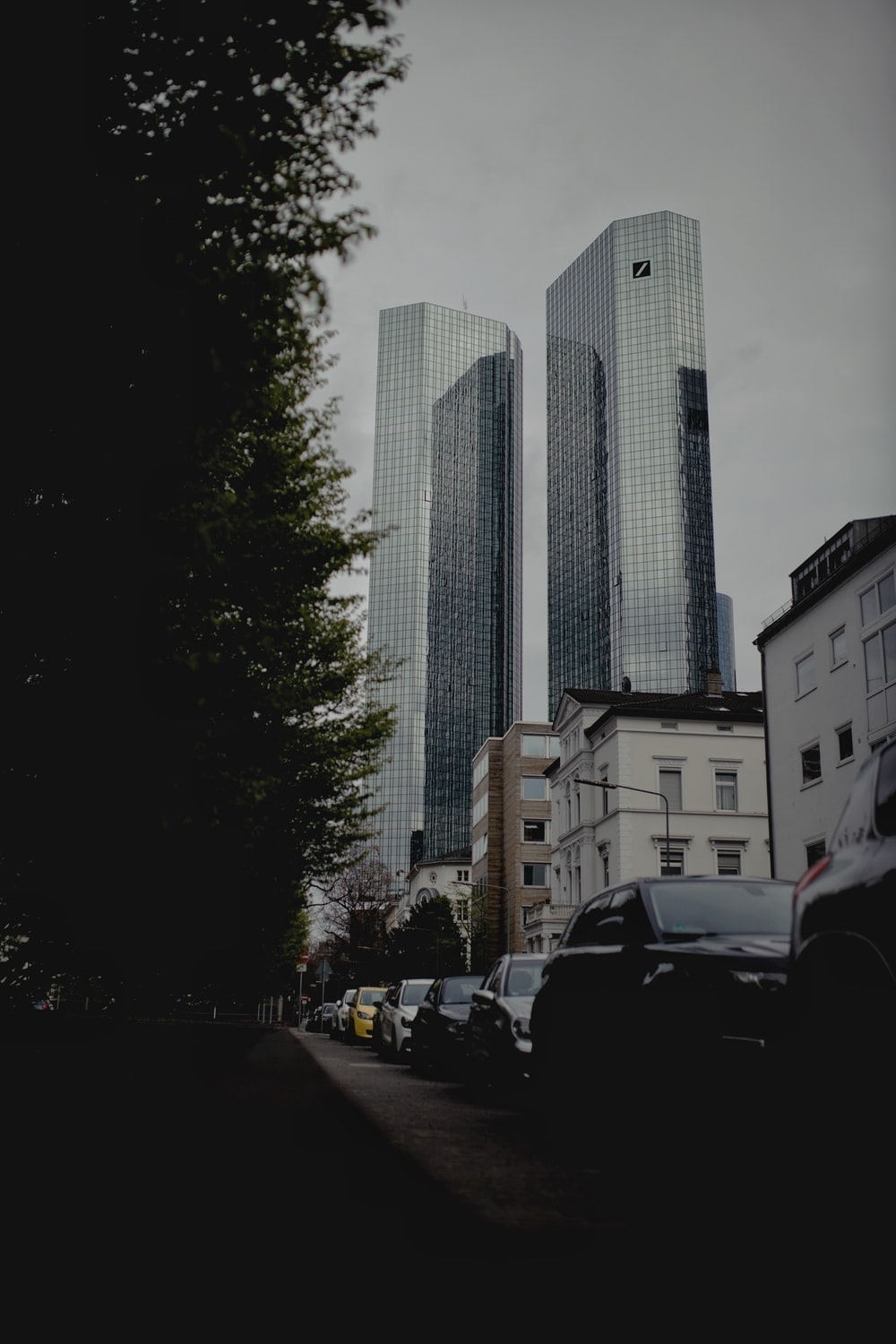 cars parked near high rise building during daytime