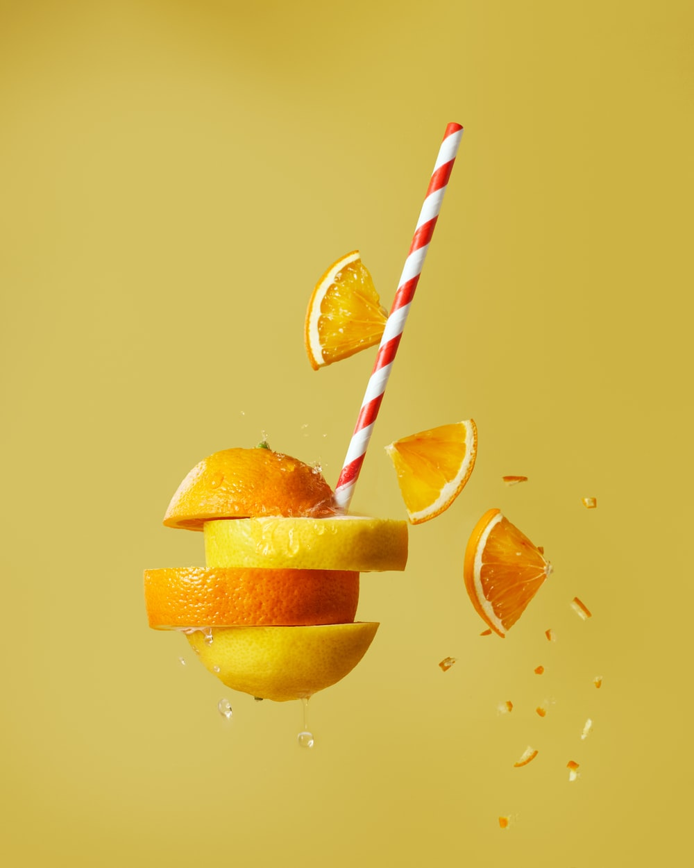 sliced orange fruit with straw