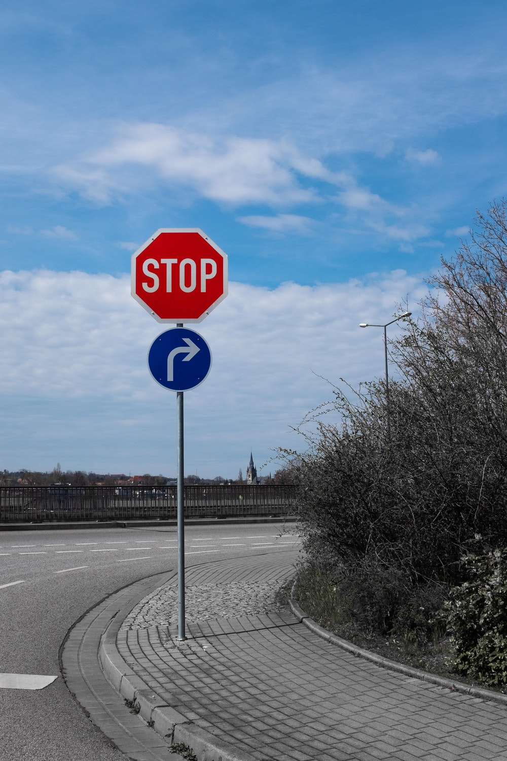 stop sign on road during daytime