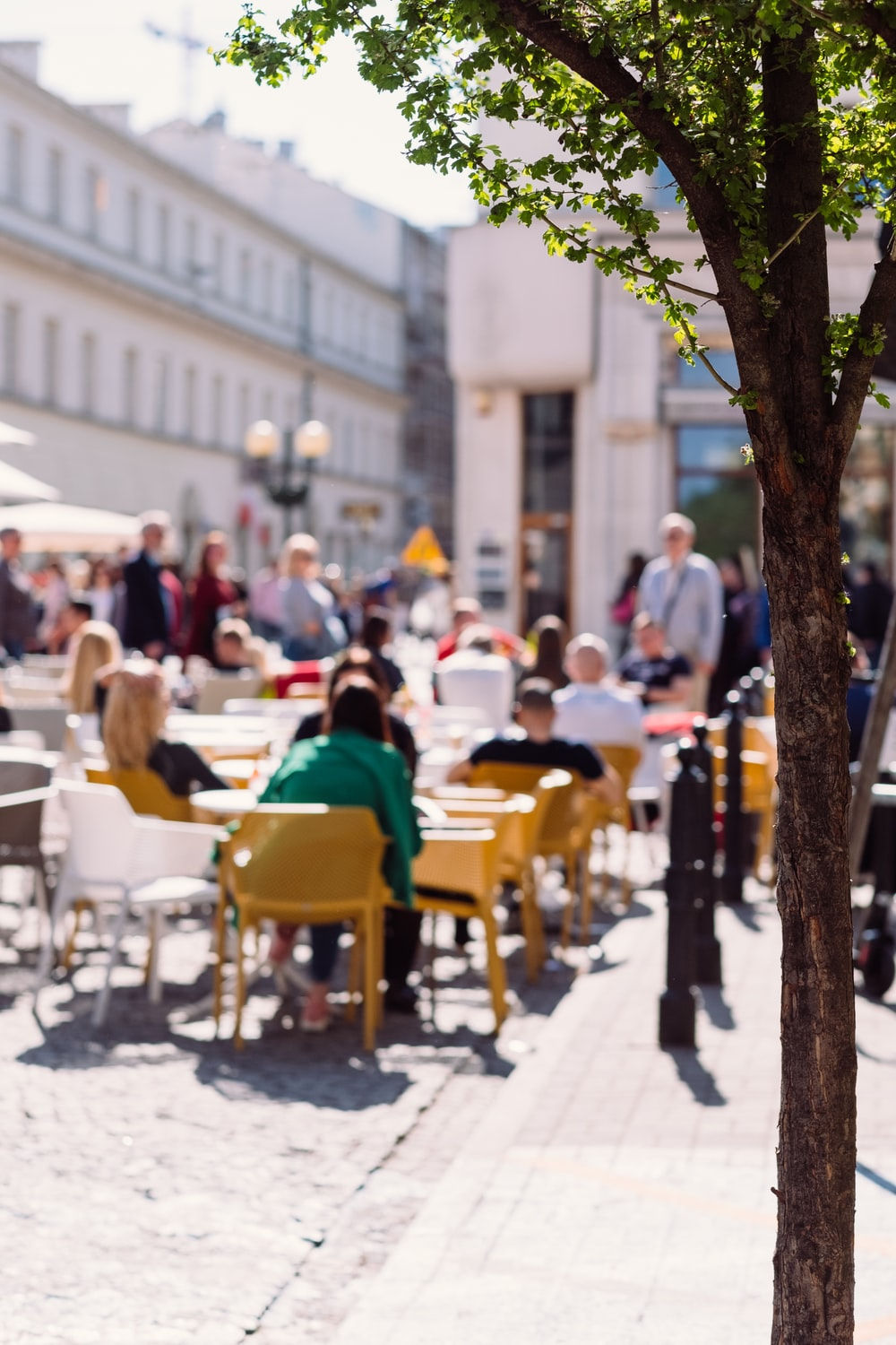 people sitting on brown wooden chairs during daytime