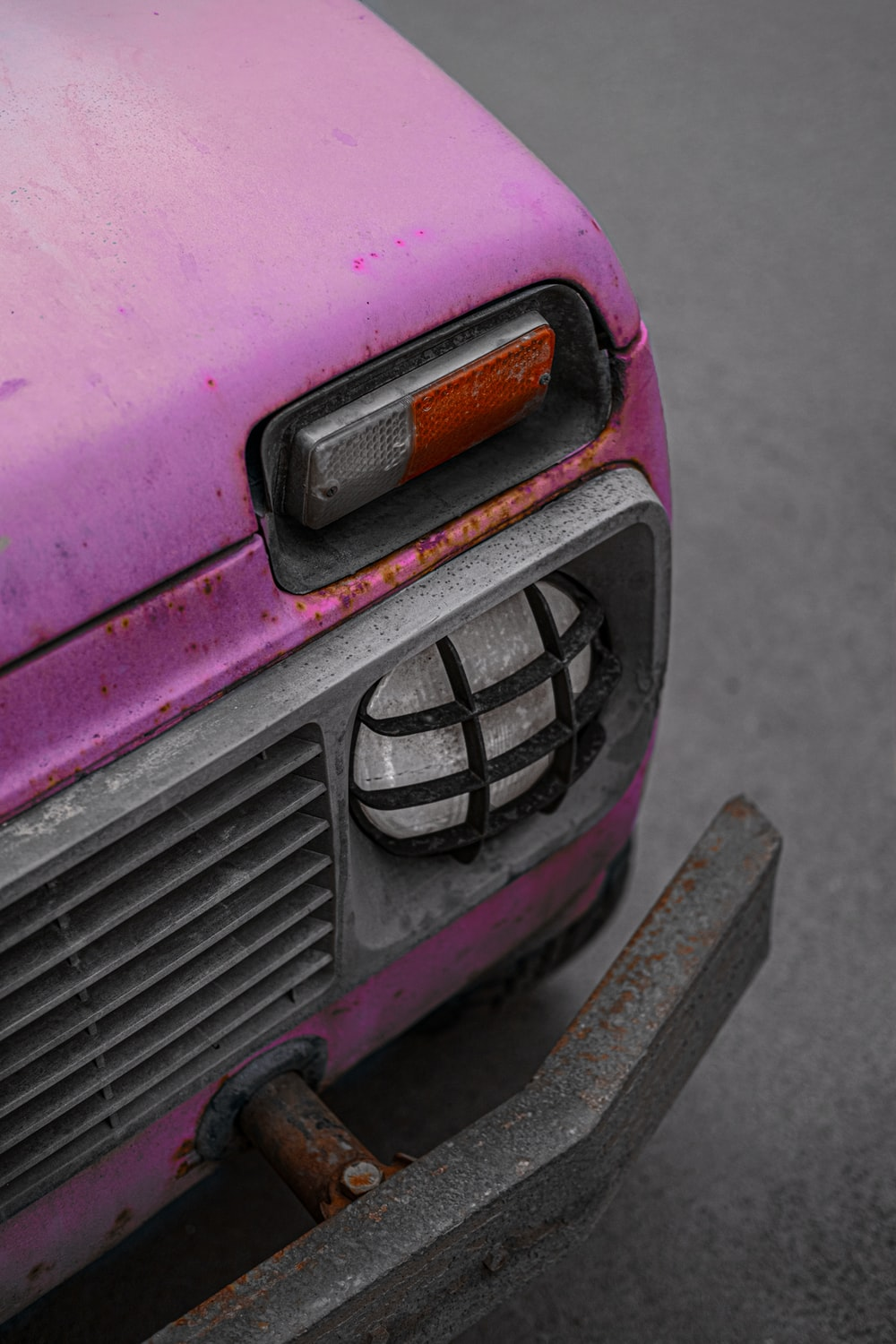 pink and black car in close up photography