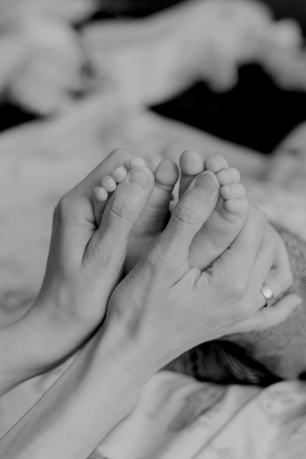 grayscale photo of persons feet