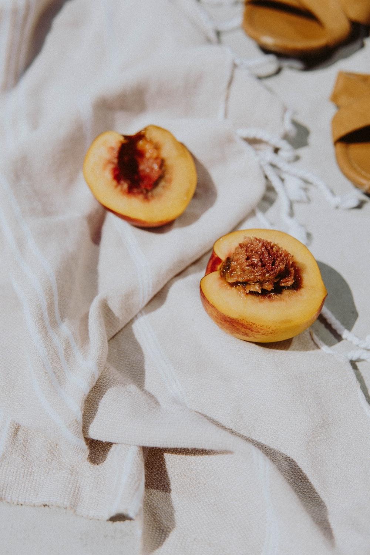 sliced apple fruit on white textile