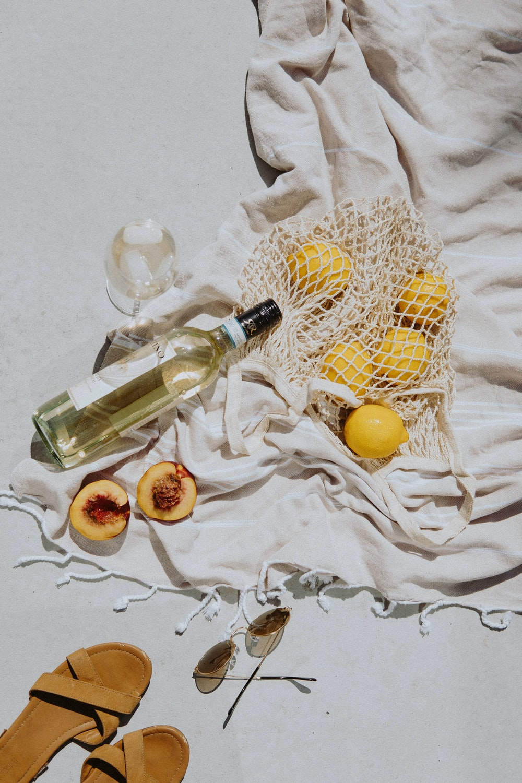 yellow and white round fruits on white textile