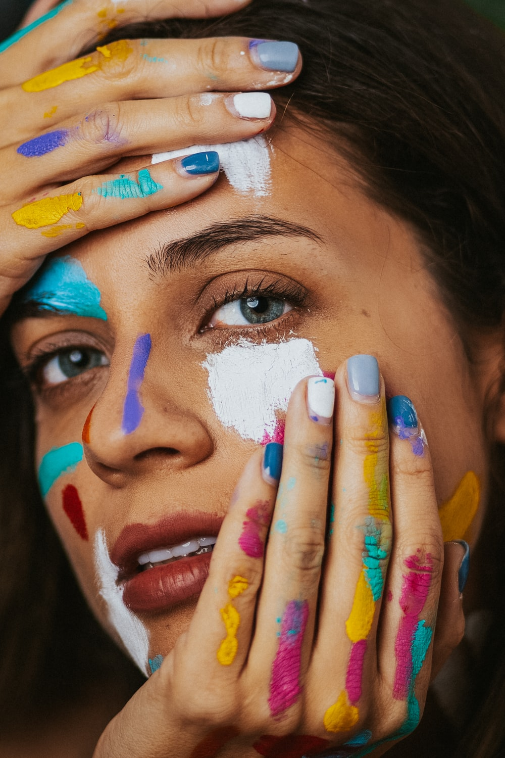 woman with blue and yellow paint on face