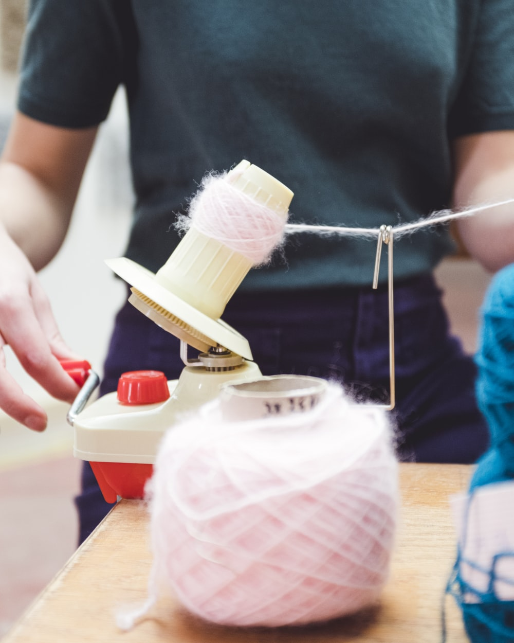 person holding white thread roll