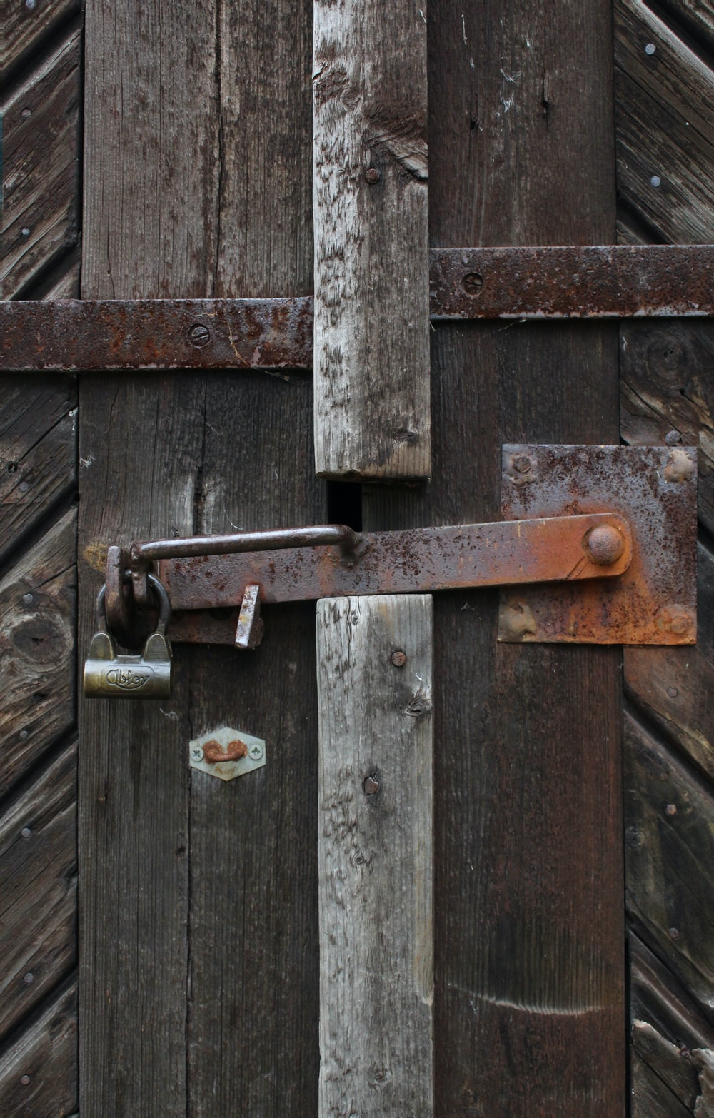 padlock on brown wooden fence