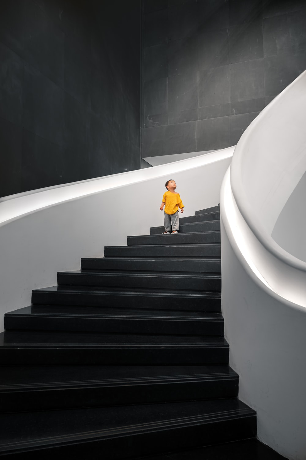 woman in yellow dress walking down the stairs