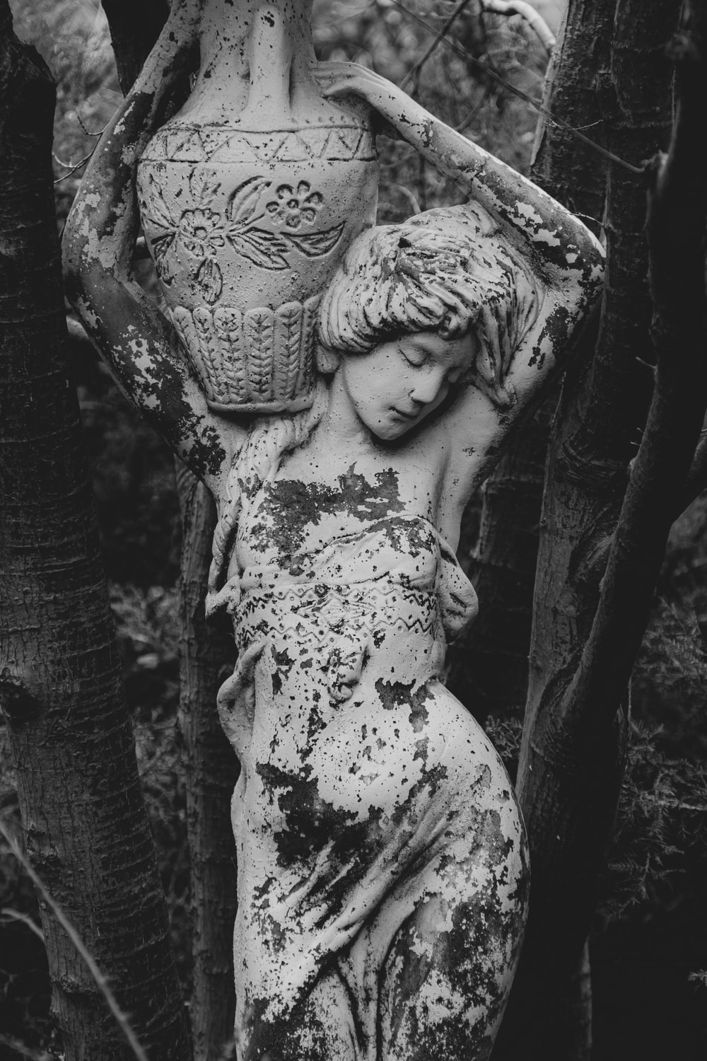 woman with floral headdress statue
