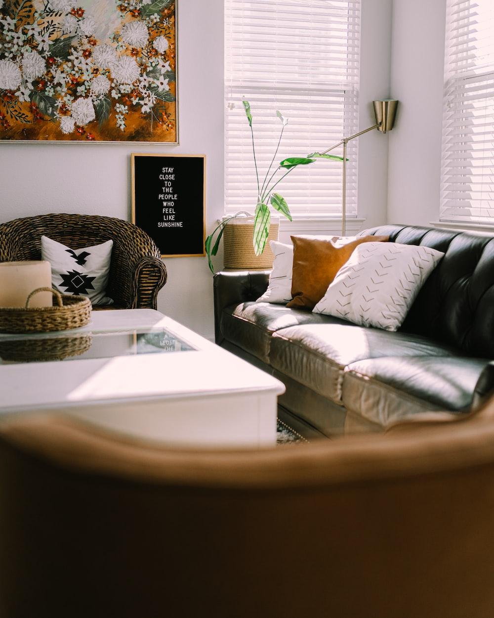 white and black throw pillows on white bed