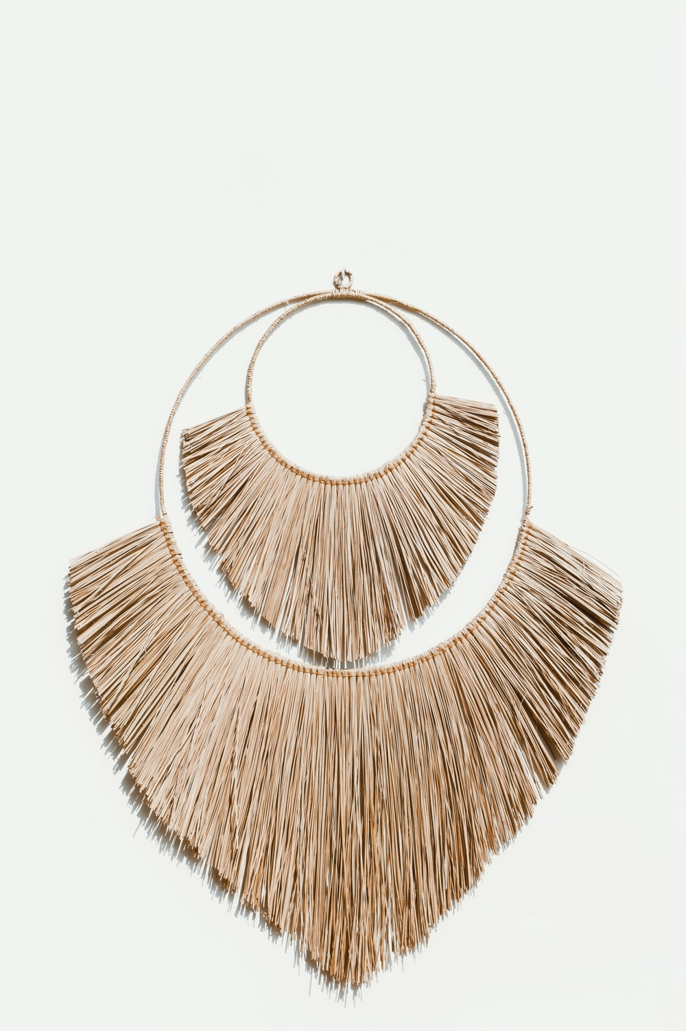 brown and silver round pendant necklace