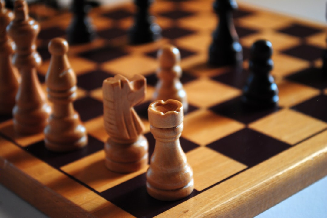 brown wooden chess piece on chess board