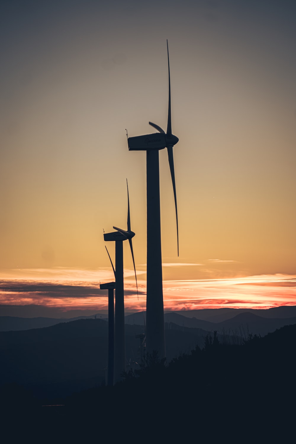 silhouette of wind mill during sunset