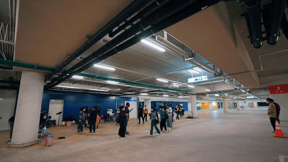 people walking on a hall