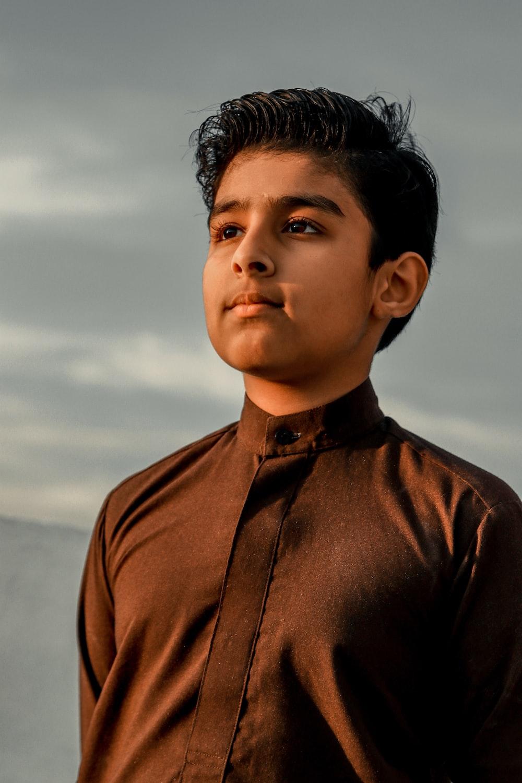 boy in brown button up shirt