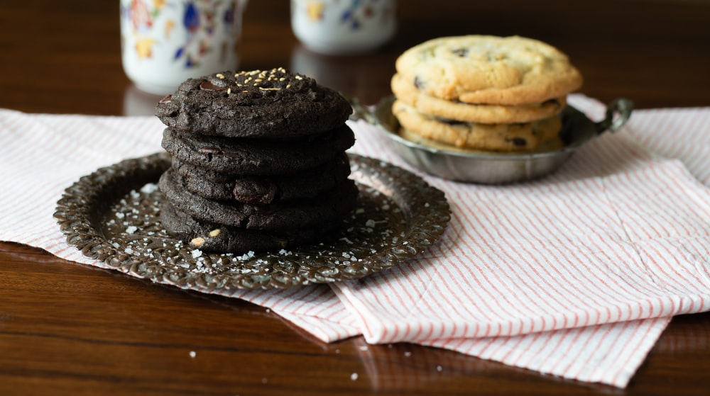 chocolate cookies on clear glass plate