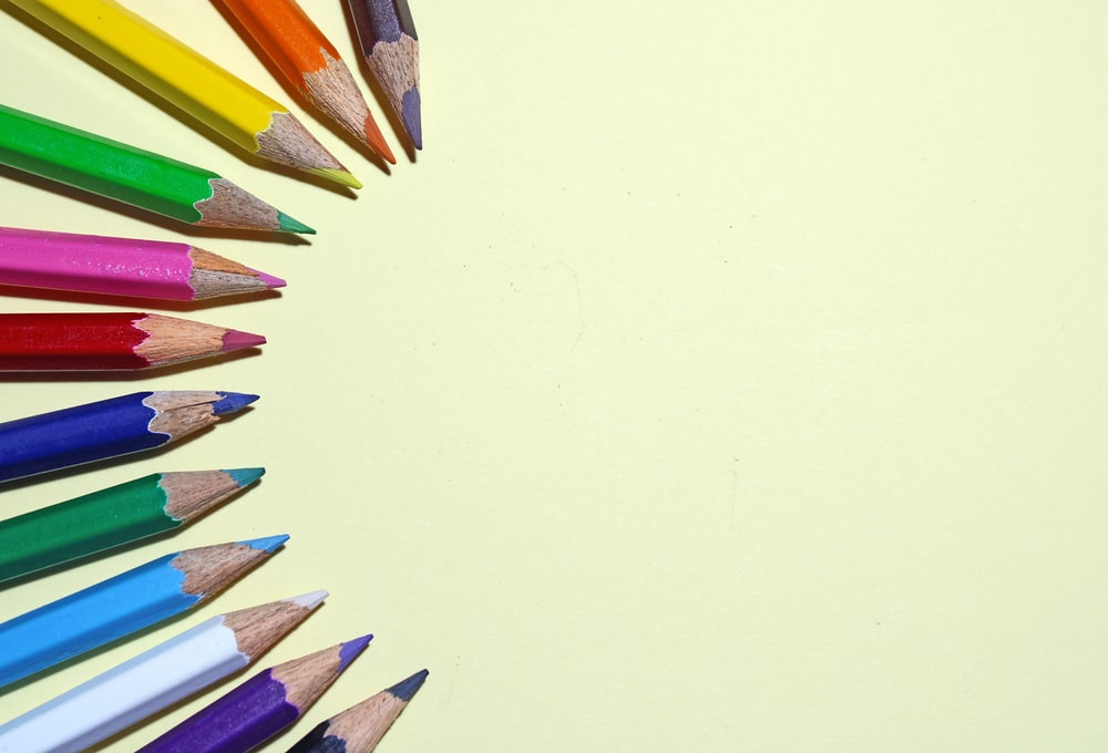 coloring pencils on white surface