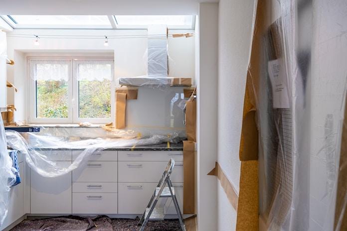 white wooden cabinet near window