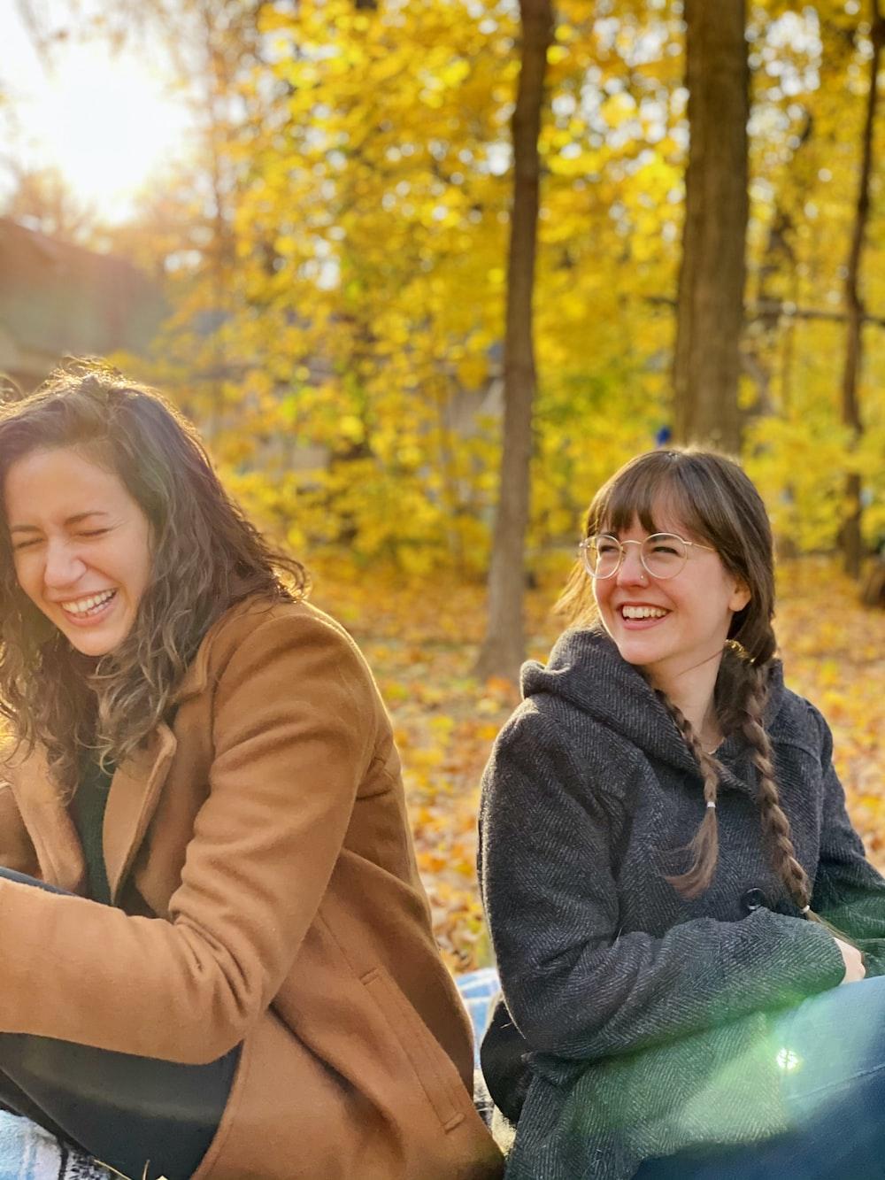 woman in brown coat sitting beside woman in brown coat