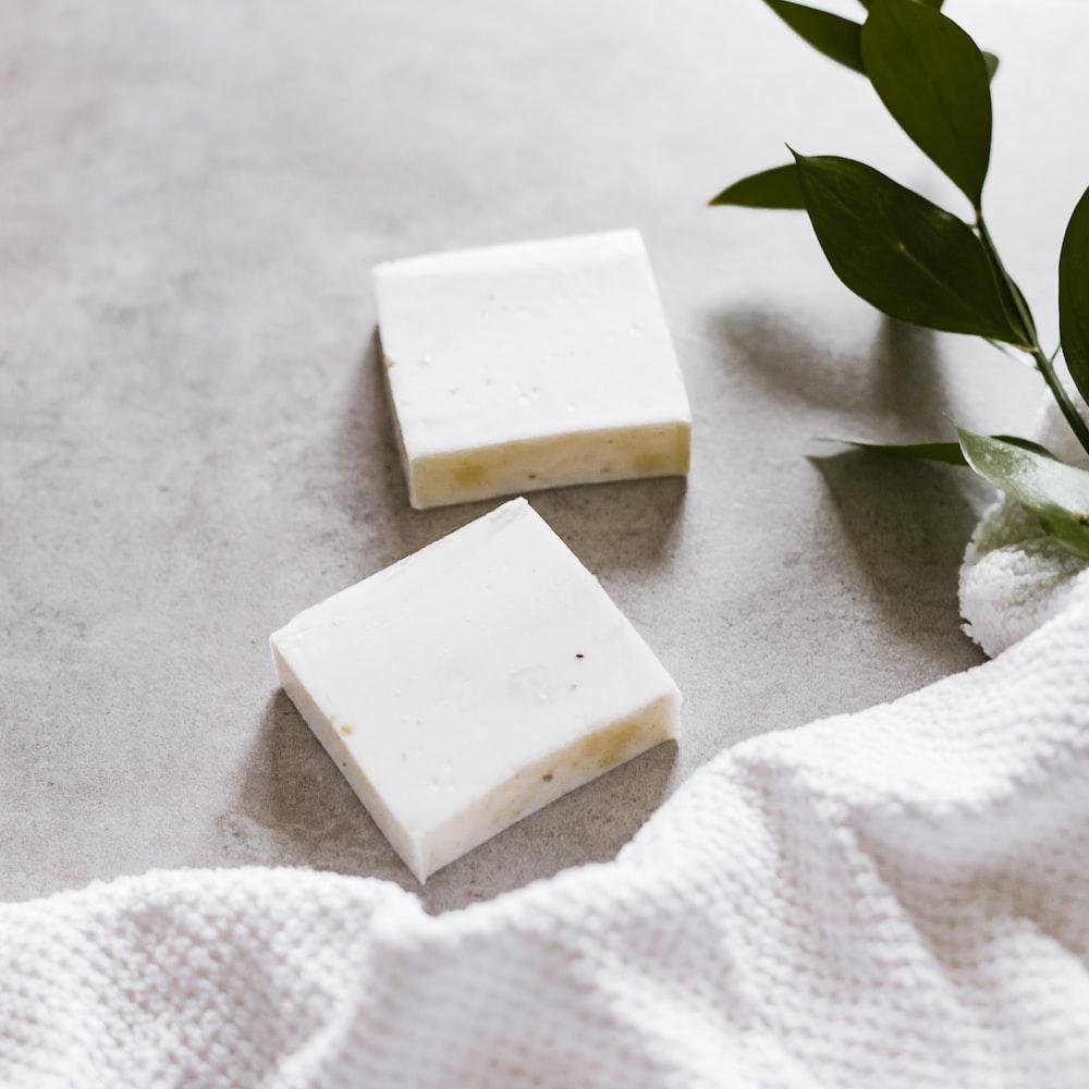 white cheese on white textile