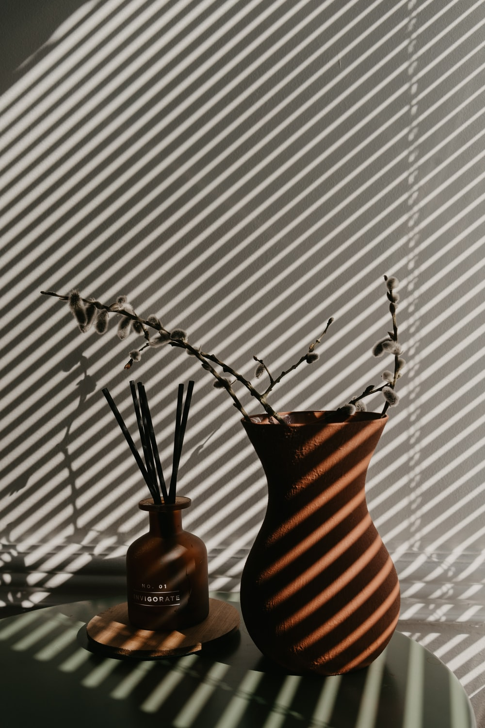 brown ceramic vase with silver spoon