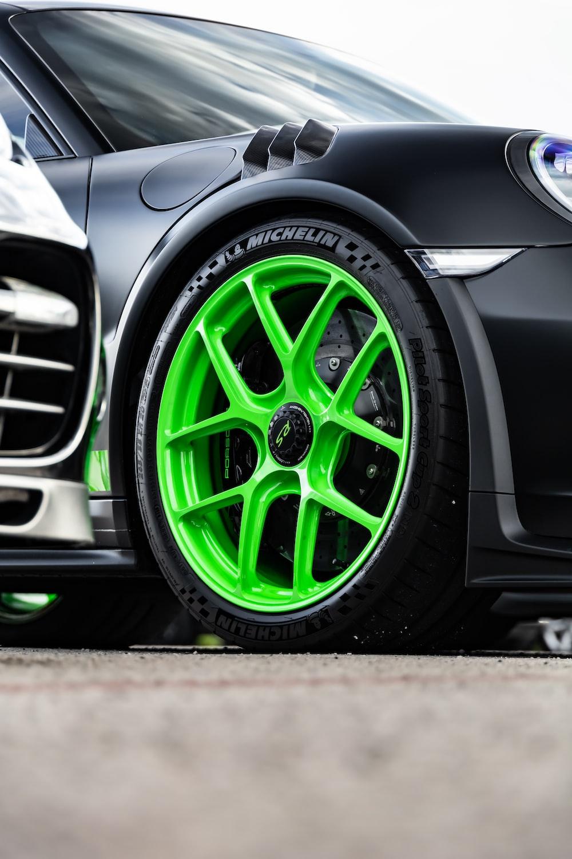 green and black car wheel