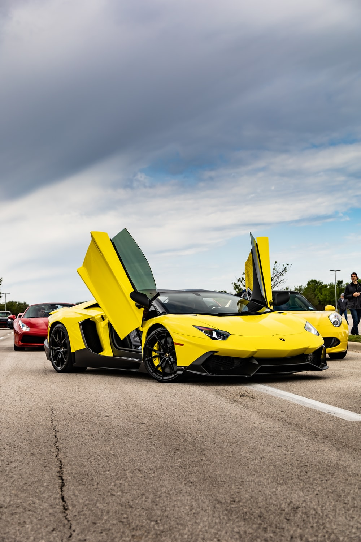 yellow ferrari 458 italia on road during daytime