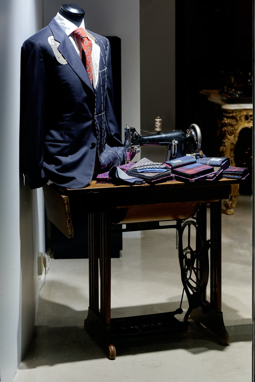black suit jacket on black and brown sewing machine