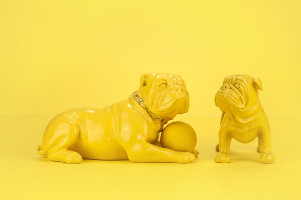 two brown dog ceramic figurines