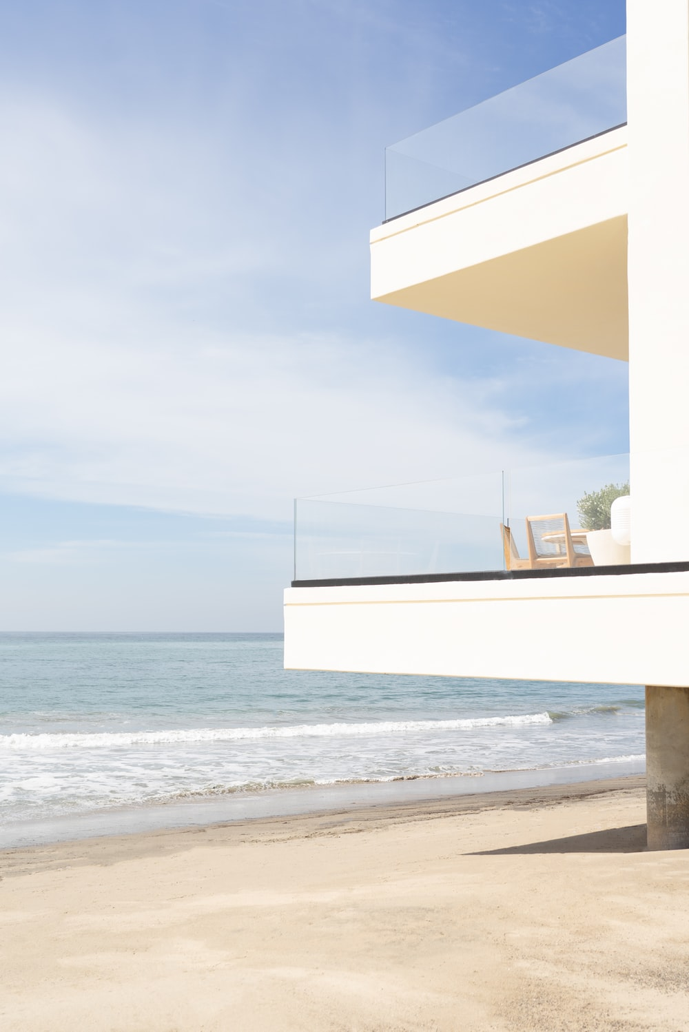 white and brown concrete building near sea during daytime