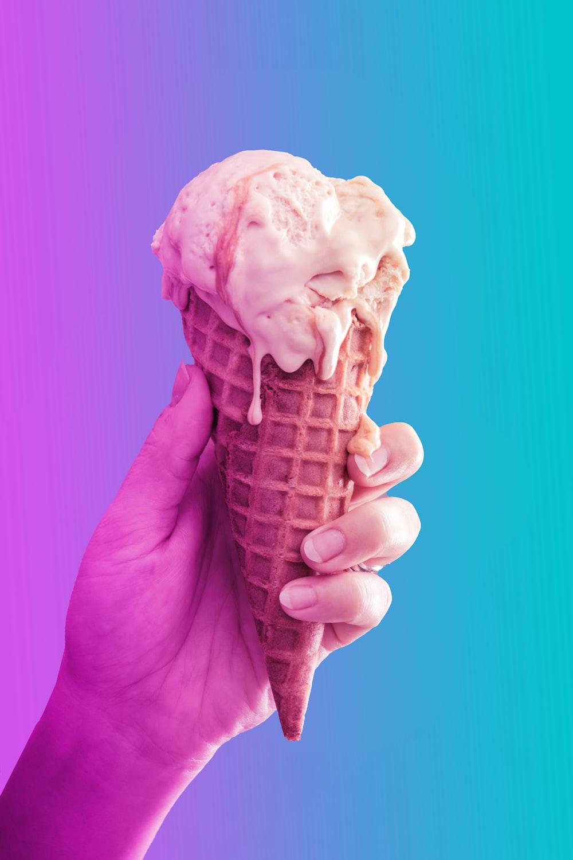 person holding ice cream cone