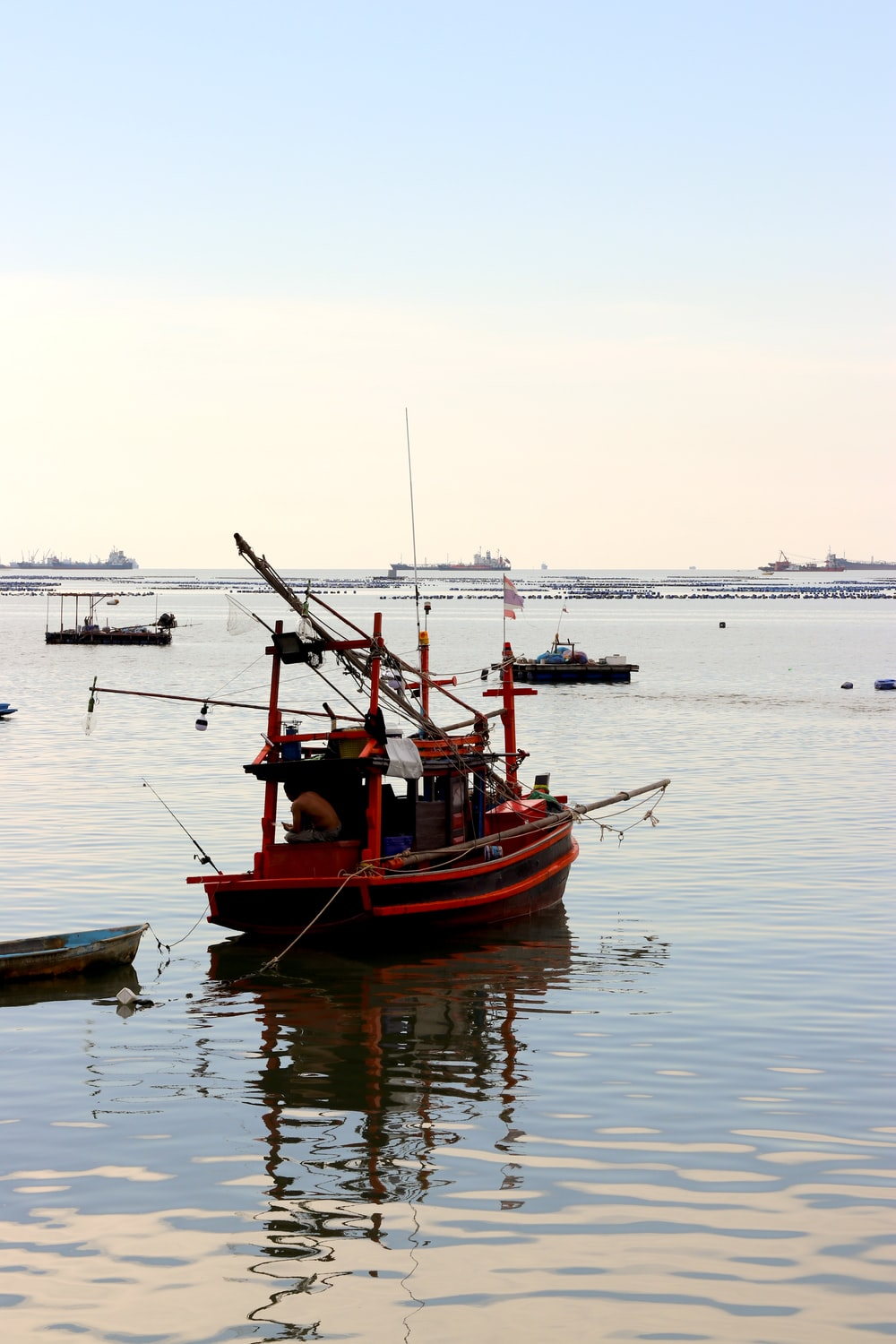 red and black boat on water during daytime