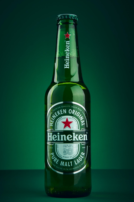heineken beer bottle on green surface