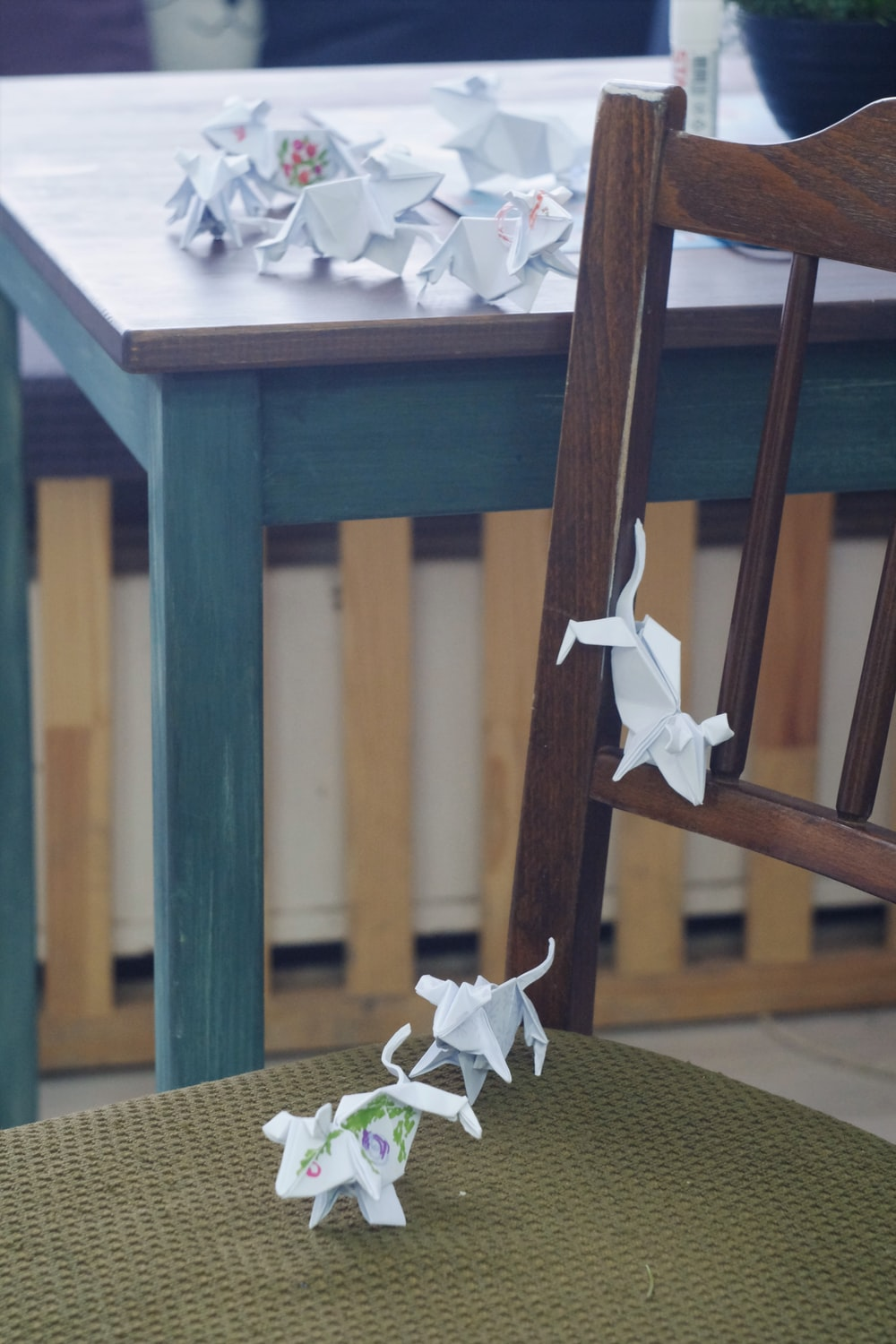 white and brown wooden table with white flower